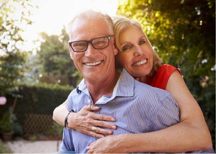 senior couple happy after learning about dental implants