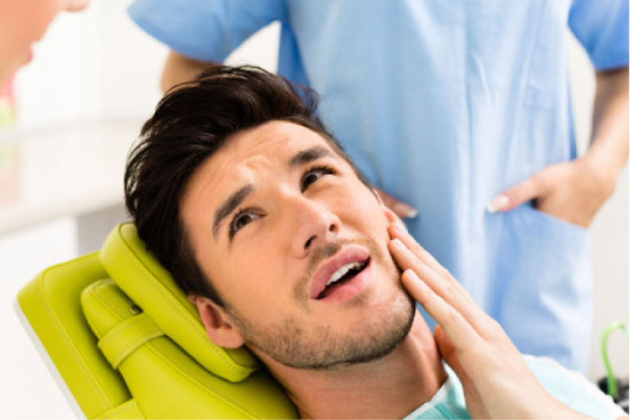 man in the dentist's chair getting an oral cancer screening