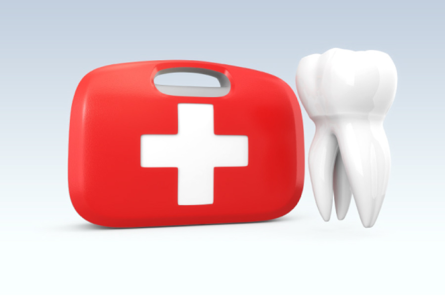 dental emergency kit next to a tooth